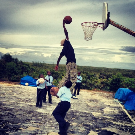 Leroy shares some dunking lessons with the James Cistern kids.