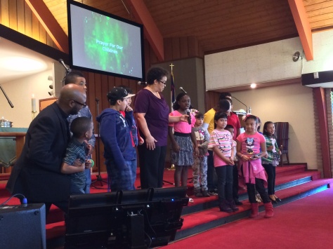 The children pray for the adults at the Gethsemane campus of St. Luke's