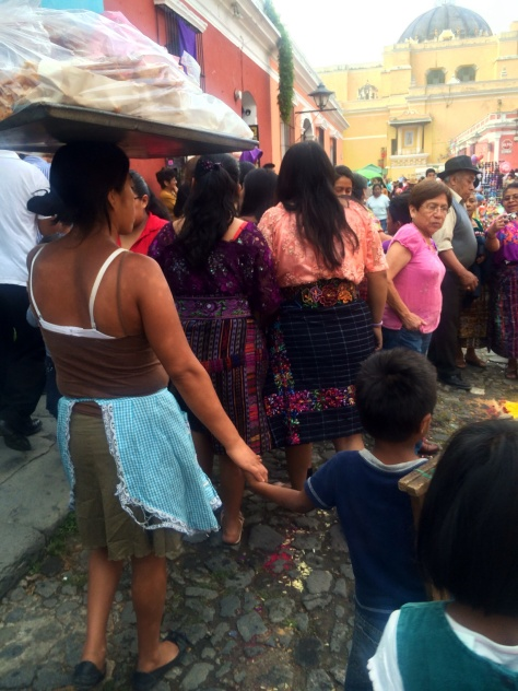 Mother holds the hand of her niño tight while they sell churros in Antigua
