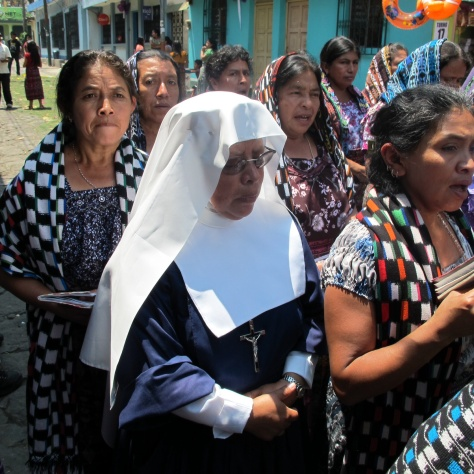 Women in ropa typica sing behind the Semana Santa processionals around Lake Atitlan